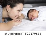 a happy mother and baby lying... | Shutterstock . vector #522179686