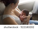 A Mother Breastfeeding Her...