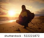 Man Sit At Evening Sea. Hiker...
