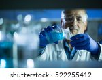 senior male researcher carrying ... | Shutterstock . vector #522255412