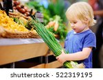 cute toddler boy in a food... | Shutterstock . vector #522319195