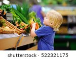 cute toddler boy in a food... | Shutterstock . vector #522321175