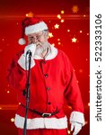 Small photo of Santa Claus singing songs against white background against bright star pattern on red