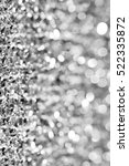 Small photo of Silver amd white glitter abstract bokeh background Christmas.