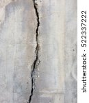 Small photo of cracked concrete texture - crack on stone background