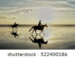 Stock photo silhouette photo of horse riding in the evening sunset time dramatic style 522400186
