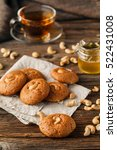 Small photo of Tea cup with oatmeal cookie on dark wooden table covert tablecloth