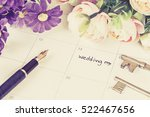 word wedding on calendar with... | Shutterstock . vector #522467656