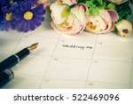 word wedding on calendar with... | Shutterstock . vector #522469096