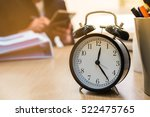 alarm clock on the table in... | Shutterstock . vector #522475765