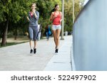 two sporty women jogging in... | Shutterstock . vector #522497902