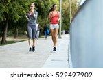 two sporty women jogging in... | Shutterstock . vector #522497902