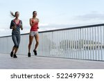 two women exercising by jogging ... | Shutterstock . vector #522497932