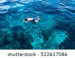 man with scuba mask floats in... | Shutterstock . vector #522617086