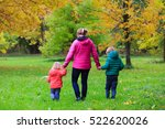 mother with two kids walking in ... | Shutterstock . vector #522620026