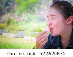 women show their faces eating... | Shutterstock . vector #522620875