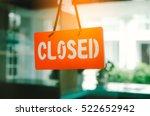 closed sign hang on mirror door ... | Shutterstock . vector #522652942
