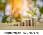 coins with plant tree on wooden ... | Shutterstock . vector #522780178