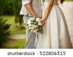 Wedding Bouquet In Hands Of...