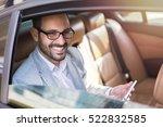 handsome business man in car.  | Shutterstock . vector #522832585