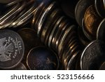 Small photo of unnecessary metal coins is heaped because of inflation and low purchasing power