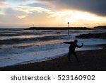 Man Silhouette Throws Rocks In...