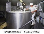 Cheesemaker Pours Rennet In A...