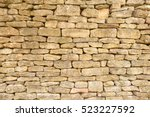 Small photo of abstract background texture of beautiful attractive old dusty dusky overlapping brownish blocked bricks wall in a local rural village in midland of England , United Kingdom