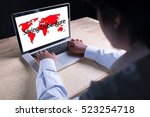 Small photo of Saving Debenture writing on laptop with world map background with businessman hand working