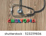 Small photo of Amblyopia colorful word on the wooden background with stethoscope