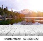 Wood Table Top On Lake And...
