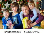 happy family in festive studio. ...   Shutterstock . vector #523339942