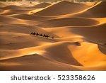 the golden dunes of erg chebbi  ... | Shutterstock . vector #523358626
