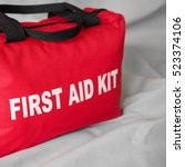 a red first aid kit bag  in... | Shutterstock . vector #523374106