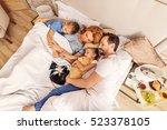 children sleeping with their... | Shutterstock . vector #523378105