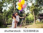 mom carrying his daughter with... | Shutterstock . vector #523384816