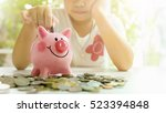 little girl putting coin into... | Shutterstock . vector #523394848