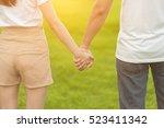 lovers in the park tenderly...   Shutterstock . vector #523411342