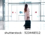 woman with a suitcase goes to... | Shutterstock . vector #523448512