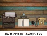 vintage typewriter and coffee... | Shutterstock . vector #523507588