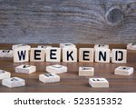 weekend from wooden letters on... | Shutterstock . vector #523515352