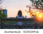 girl sitting on a bench and... | Shutterstock . vector #523524916