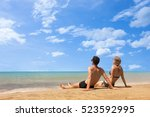 couple on tropical sea beach... | Shutterstock . vector #523592995