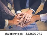 united hands of business team... | Shutterstock . vector #523603072
