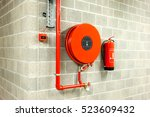 an fire hose hanging on the... | Shutterstock . vector #523609432