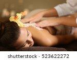 young woman receiving salt... | Shutterstock . vector #523622272