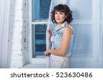 young beautiful woman standing... | Shutterstock . vector #523630486