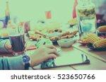 group of people having dinner... | Shutterstock . vector #523650766