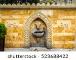 Small photo of Stone decoration water source. Watering can. Decoration water source in summer city park. Antique water source. Water source decorative. Town water source. City water source. Drinking water source