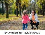 daughter running to her mom in... | Shutterstock . vector #523690438